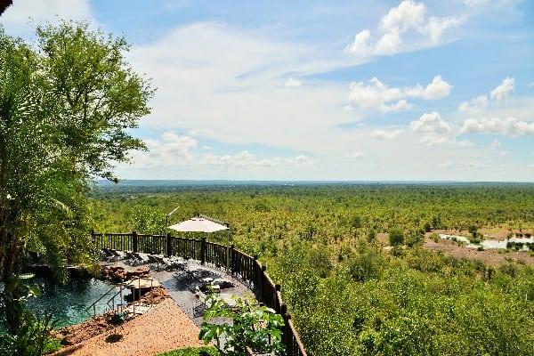 Swimming Pool and waterhole at Victoria Falls Safari Lodge