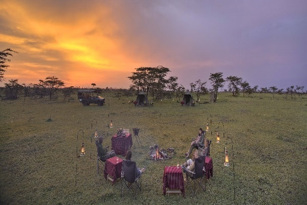 naboisho-camp-fly-camping-sunset-guests-masai-mara-kenya