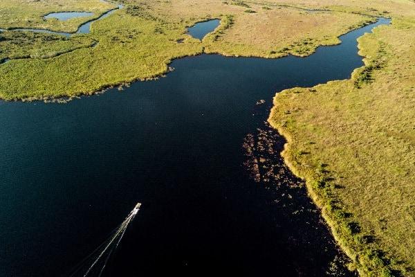 xugana-island-lodge-boat-aerial-okavango-botswana